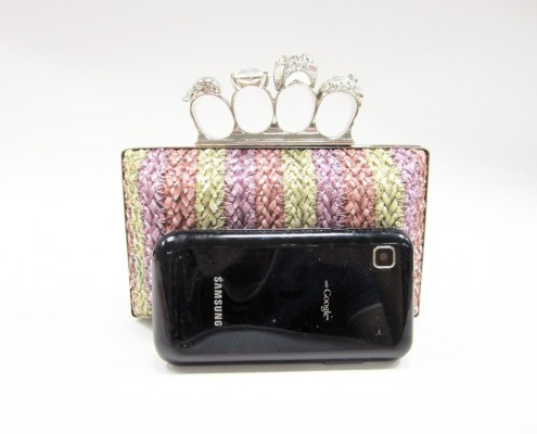 Skull finger rings woven PU clutch bag contrast with mobile