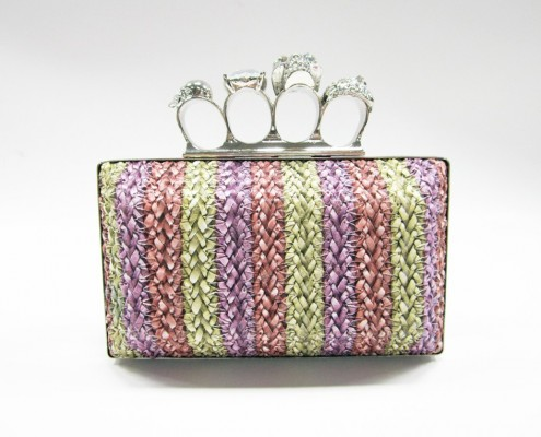 Skull finger rings woven PU clutch bag front view