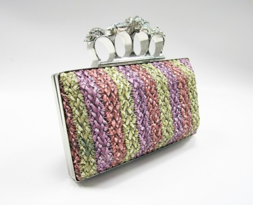 Skull finger rings woven PU clutch bag side view