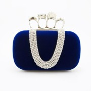 Velvet purse with skull knuckle finger rings frame evening bag