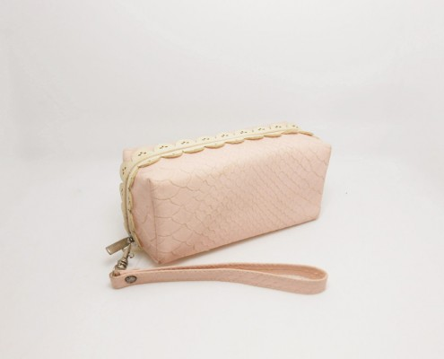 lady women's pink cosmetic wristlet bag