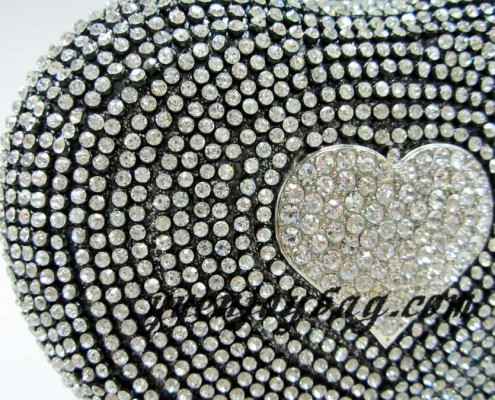 Grey heart shaped evening clutch bag with all over diamond - detail view